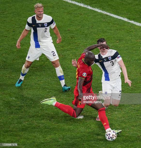 Daniel O'Shaughnessy of Finland in action against Michy Batshuayi of Belgium during the EURO 2020 Group B third match between Finland and Belgium at...