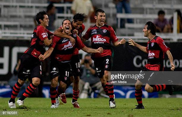 Daniel Osorno of Atlas celebrates scored goal with teammates during their match in the 2009 Opening tournament the closing stage of the Mexican...