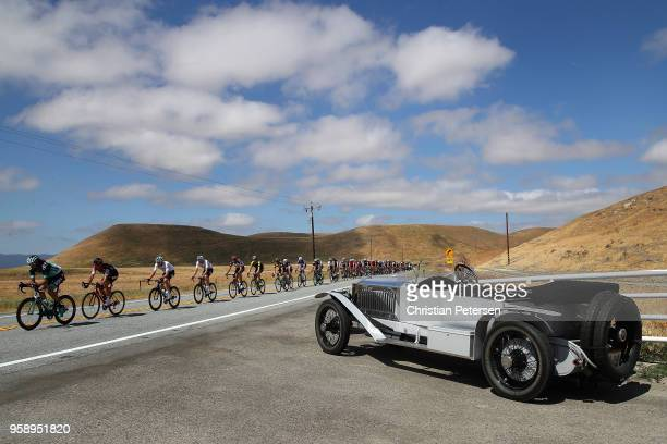 Daniel Oss of Italy and Team Bora - Hansgrohe leads a group of riders past a vintage Rolls Royce Silver Ghost during stage three of the 13th Amgen...