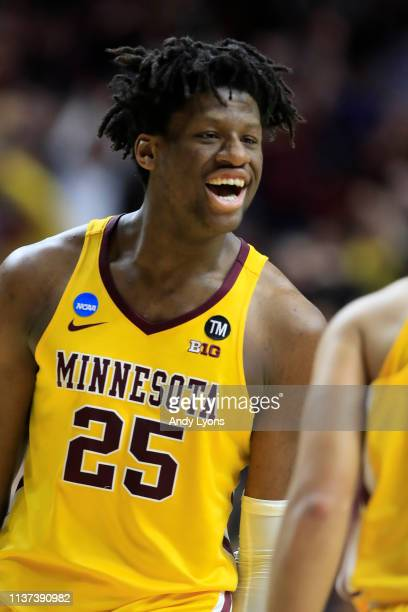 Daniel Oturu of the Minnesota Golden Gophers celebrates after a play against the Louisville Cardinals during their game in the First Round of the...