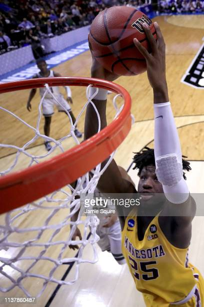 Daniel Oturu of the Minnesota Golden Gophers dunks the ball against the Michigan State Spartans during the second half in the second round game of...