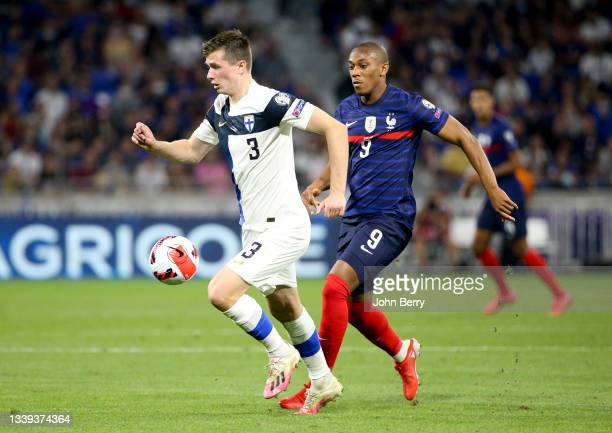 """Daniel O""""u2019Shaughnessy of Finland, Anthony Martial of France during the 2022 FIFA World Cup Qualifier match between France and Finland at Groupama..."""