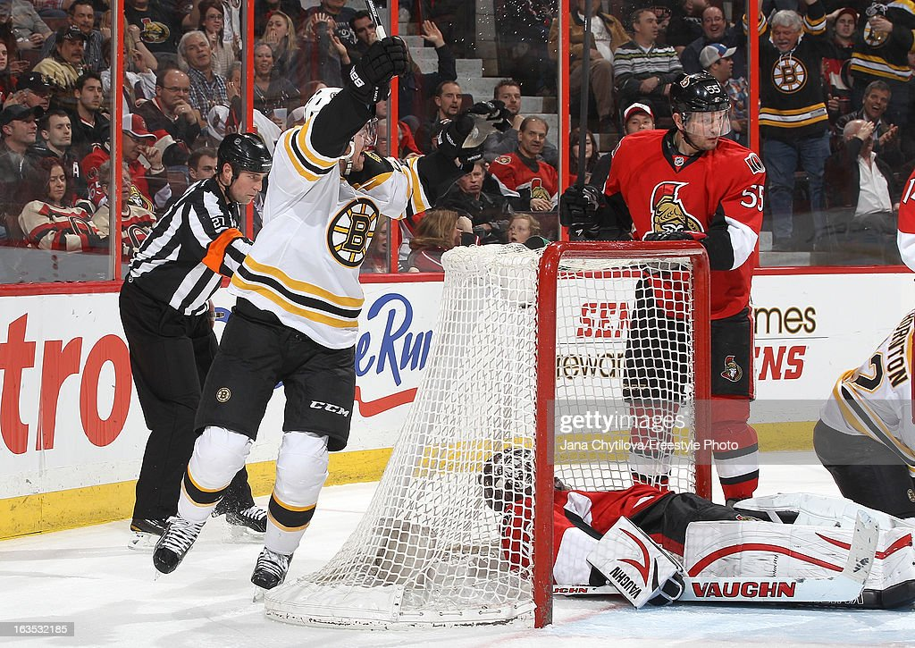 Daniel Paille #20 of the Boston Bruins celebrates a first period goal as Robin Lehner #40 of the Ottawa Senators lays on the puck and Sergei Gonchar #55 of the Ottawa Senators looks on, during an NHL game at Scotiabank Place, on March 11, 2013 in Ottawa, Ontario, Canada.