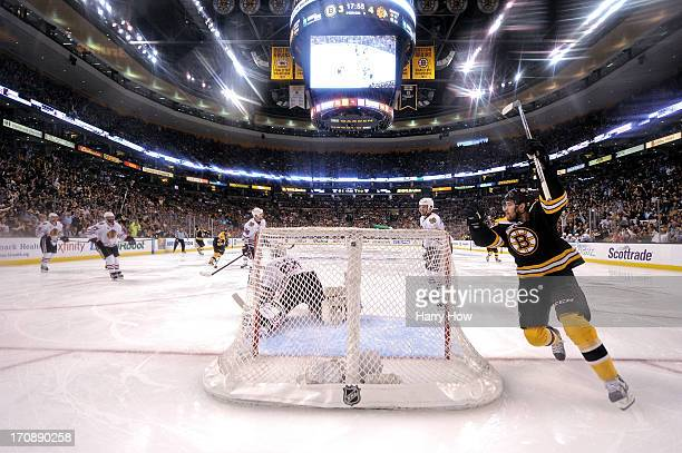 Daniel Paille of the Boston Bruins celebrates a goal in the third period by Patrice Bergeron against Corey Crawford of the Chicago Blackhawks in Game...