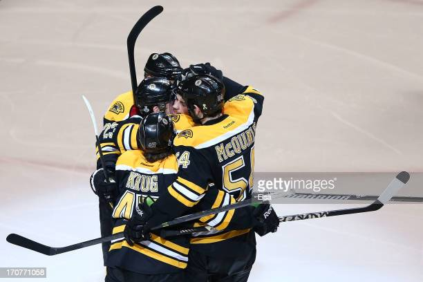 Daniel Paille of the Boston Bruins celebrates with Chris Kelly Torey Krug and Adam McQuaid after scoring in the second period against the Chicago...