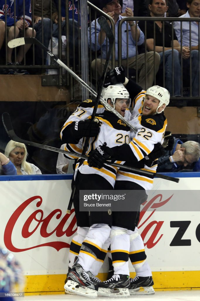 Daniel Paille #20 of the Boston Bruins celebrates with teammates Dougie Hamilton #27 and Shawn Thornton #22 after scoring a goal in the third period to make the score 2-1 against Henrik Lundqvist #30 of the New York Rangers in Game Three of the Eastern Conference Semifinals during the 2013 NHL Stanley Cup Playoffs at Madison Square Garden on May 21, 2013 in New York City.
