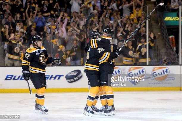 Daniel Paille of the Boston Bruins celebrates with Tyler Seguin and Torey Krug after scoring in the second period against the Chicago Blackhawks in...