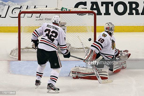 Daniel Paille of the Boston Bruins scores a goal against Corey Crawford of the Chicago Blackhawks during the second period in Game Three of the 2013...