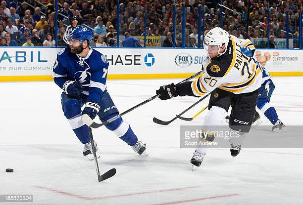 Daniel Paille of the Boston Bruins shoots the puck by Radko Gudas of the Tampa Bay Lightning during the second period at the Tampa Bay Times Forum on...