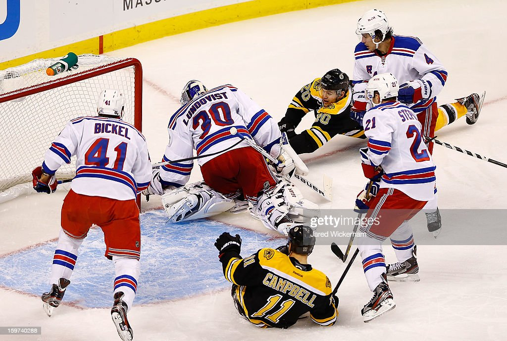 Daniel Paille #20 of the Boston Bruins takes a diving shot in front of Henrik Lundqvist #30 of the New York Rangers in the second period during the season opener game on January 19, 2013 at TD Garden in Boston, Massachusetts.