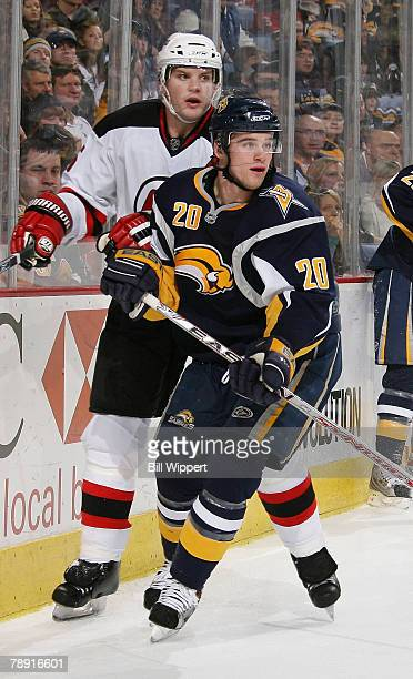 Daniel Paille of the Buffalo Sabres skates against Colin White of the New Jersey Devils on January 12, 2008 at HSBC Arena in Buffalo, New York.