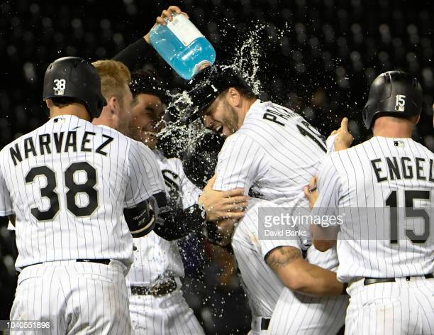 Daniel Palka of the Chicago White Sox is mobbed by his teammates after hitting a tworun game winning single against the Cleveland Indians during the...