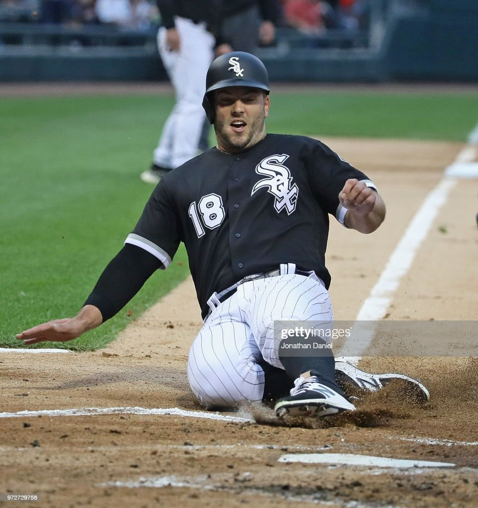 Daniel Palka #18 of the Chicago White Sox slides in to score a run in the 1st inning against the Cleveland Indians at Guaranteed Rate Field on June 12, 2018 in Chicago, Illinois.