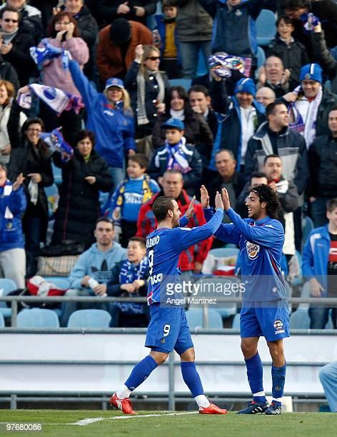 Daniel Parejo of Getafe celebrates after scoring with his team mate Roberto Soldado during the La Liga match between Getafe and Mallorca at Coliseum...