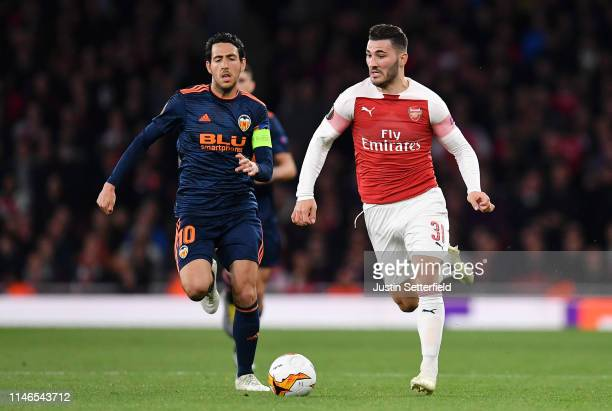 Daniel Parejo of Valencia battles for possession with Sead Kolasinac of Arsenal during the UEFA Europa League Semi Final First Leg match between...