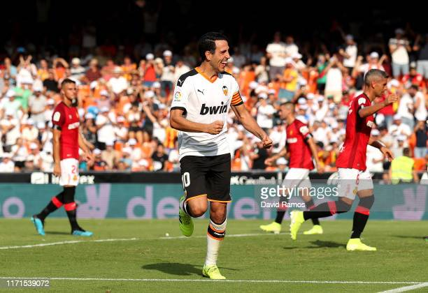 Daniel Parejo of Valencia celebrates after scoring his sides second goal during the Liga match between Valencia CF and RCD Mallorca at Estadio...