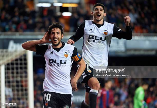 Daniel Parejo of Valencia celebrates after scoring his sides third goal with his teammate Goncalo Guedes during the La Liga match between Valencia...