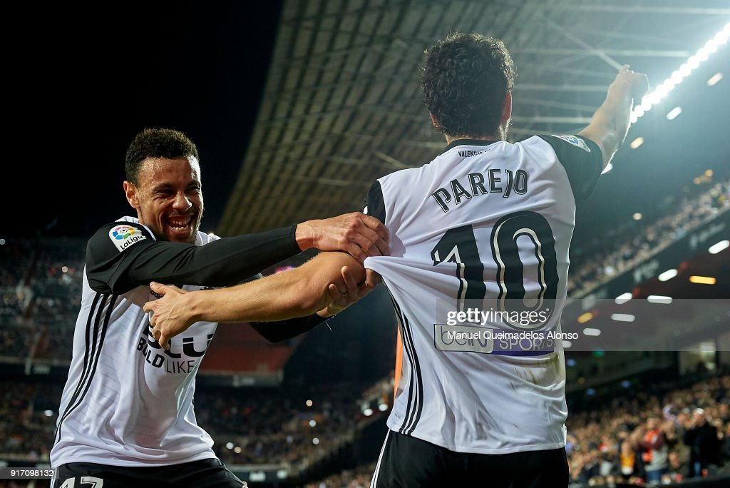 Daniel Parejo (R) of Valencia celebrates after scoring his sides third goal with his teammate Francis Coquelin during the La Liga match between Valencia and Levante at Mestalla Stadium on February 11, 2018 in Valencia, Spain.