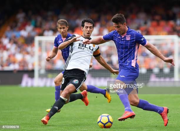 Daniel Parejo of Valencia CF and Gabriel Pires of Club Deportivo Leganes in action during the La Liga match between Valencia CF and Club Deportivo...