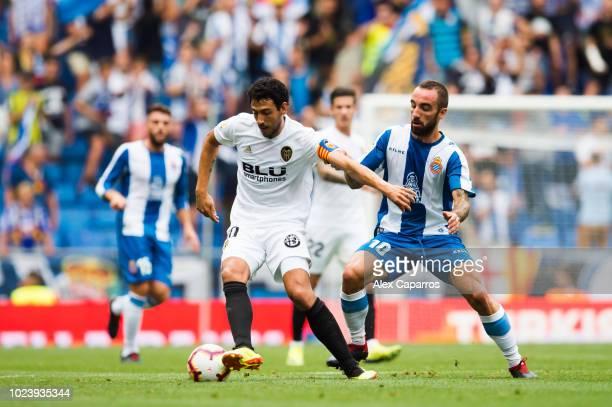 Daniel Parejo of Valencia CF controls the ball under pressure from Sergi Darder of RCD Espanyol during the La Liga match between RCD Espanyol and...