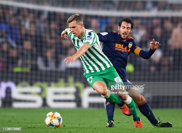 Daniel Parejo of Valencia CF duels for the ball with Giovani Lo Celso of Real Betis during the Copa del Semi Final first leg match between Real Betis...