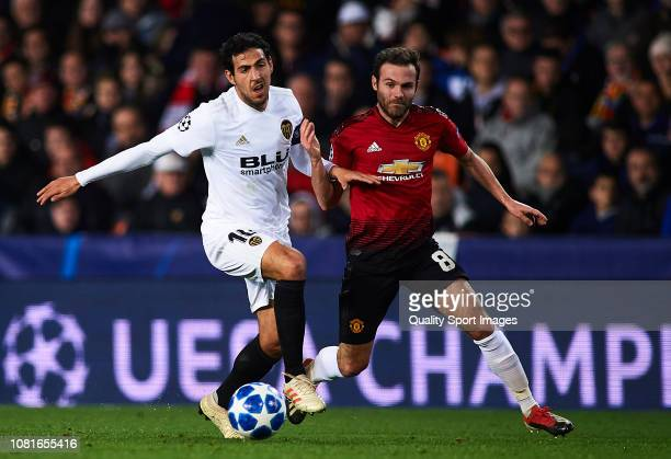 Daniel Parejo of Valencia competes for the ball with Juan Mata of Manchester United during the UEFA Champions League Group H match between Valencia...