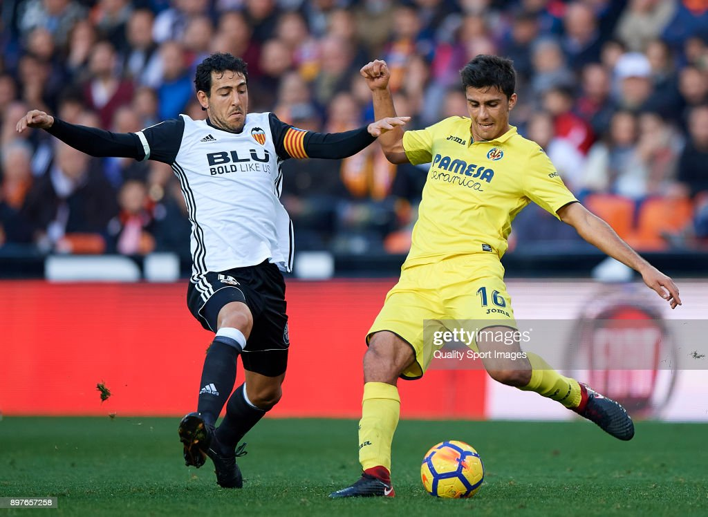 Daniel Parejo (L) of Valencia competes for the ball with Rodrigo Hernandez of Villarreal during the La Liga match between Valencia and Villarreal at Mestalla Stadium on December 23, 2017 in Valencia, Spain.