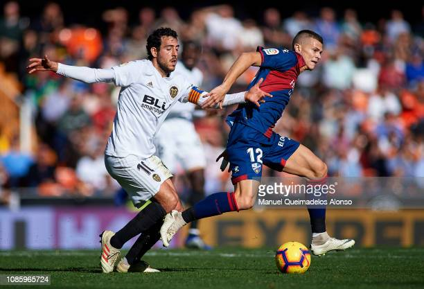 Daniel Parejo of Valencia competes for the ball with Samuele Longo of Huesca during the La Liga match between Valencia CF and SD Huesca at Estadio...