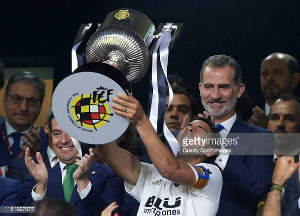 Daniel Parejo of Valencia lifts the trophy after winning with his team the Spanish Copa del Rey Final match between FC Barcelona and Valencia CF at...