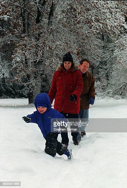 Daniel Parish 3 1/2 prepares to take a spill while walking through a Yosemite Valley meadow with his parents Diane Parish 44 and Paul Gelburd 45 they...