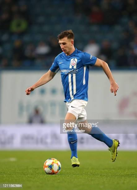 Daniel Patrick Hanslik of Hansa Rostock runs with the ball during the 3 Liga match between Hansa Rostock and Eintracht Braunschweig at Ostseestadion...