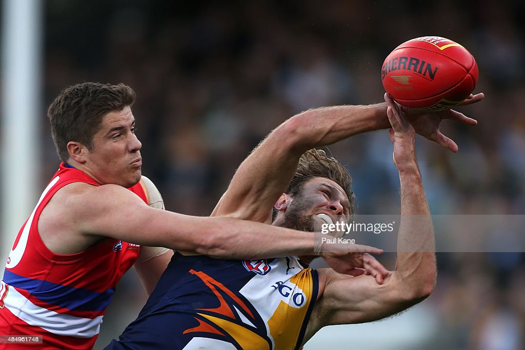 Daniel Pearce of the Bulldogs spoils the mark for Mark Hutchings of the Eagles during the round 21 AFL match between the West Coast Eagles and Western Bulldogs at Domain Stadium on August 23, 2015 in Perth, Australia.