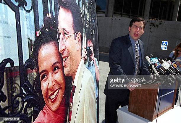 Daniel Pearl's childhood friend Daniel Gill speaks to reporters next to a 1999 wedding photo of Pearl and his wife Mariane at Skirball center in Los...