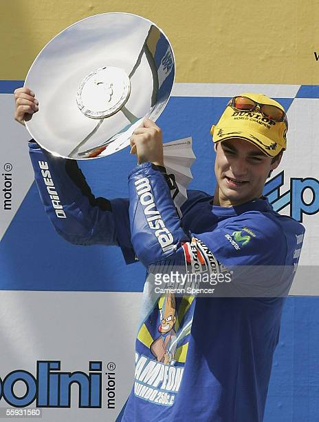 Daniel Pedrosa of Spain and Telefonica MoviStar Honda 250 celebrates winning the 250cc race and Championship at the Australian MotoGP at the Phillip...