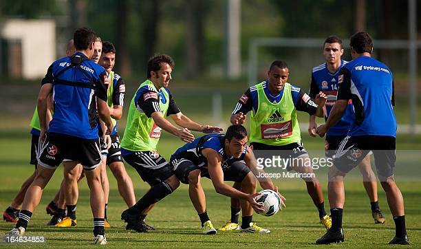 Daniel Petkovski is challenged by Alessandro Del Piero and Yairo Yau during a Sydney FC training session at Macquarie Uni on March 26 2013 in Sydney...
