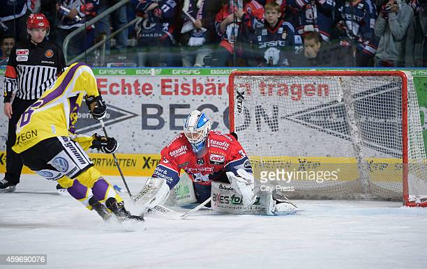 Daniel Pietta of Krefeld Pinguine and Petri Vehanen of the Eisbaeren Berlin during the game between Eisbaeren Berlin and Krefeld Pinguine on November...