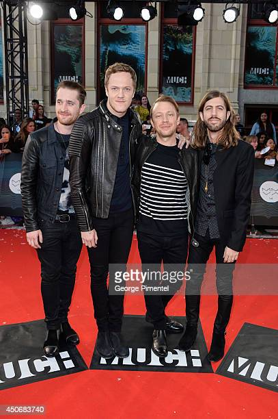 Daniel Platzman Dan Reynolds Ben McKee and Wayne Sermon of Imagine Dragons arrive at the 2014 MuchMusic Video Awards at MuchMusic HQ on June 15 2014...