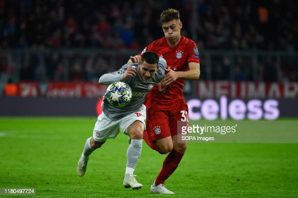Daniel Podence from Olympiacos and Joshua Kimmich from Bayern seen in action during the UEFA Champions League group B match between Bayern and...