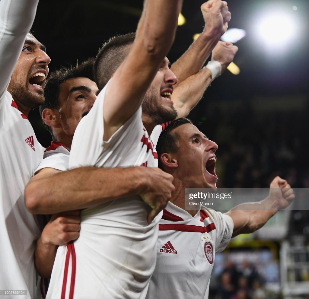 Daniel Podence of Olympiakos celebrates with team mates after scoring during the UEFA Europa League qualifing second leg play off match between Burnley and Olympiakos at Turf Moor on August 30, 2018 in Burnley, England.