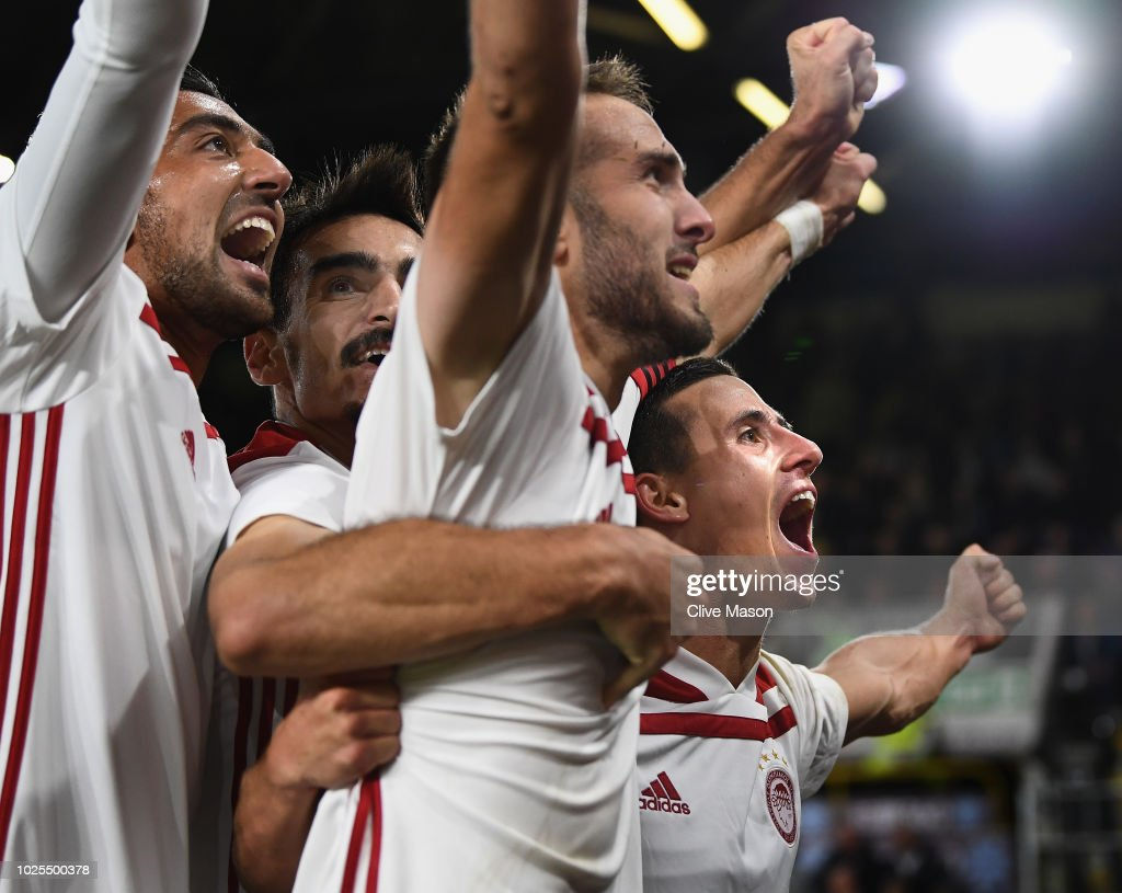 Daniel Podence of Olympiakos (bottom right) celebrates with team mates after scoring during the UEFA Europa League qualifing second leg play off match between Burnley and Olympiakos at Turf Moor on August 30, 2018 in Burnley, England.