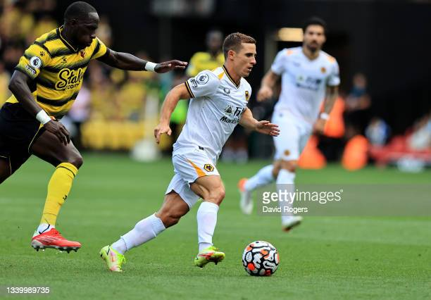 Daniel Podence of Wolverhampton Wanderers breaks away from Moussa Sissoko during the Premier League match between Watford and Wolverhampton Wanderers...