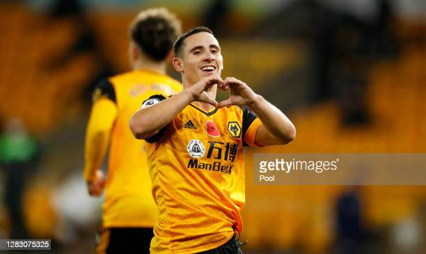 Daniel Podence of Wolverhampton Wanderers celebrates after scoring his team's second goal during the Premier League match between Wolverhampton...