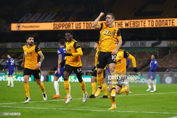 Daniel Podence of Wolverhampton Wanderers celebrates after scoring their team's first goal during the Premier League match between Wolverhampton...