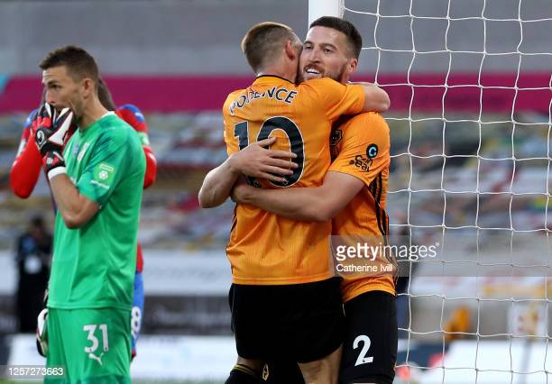 Daniel Podence of Wolverhampton Wanderers celebrates with teammate Matt Doherty of Wolverhampton Wanderers after scoring his team's first goal during...