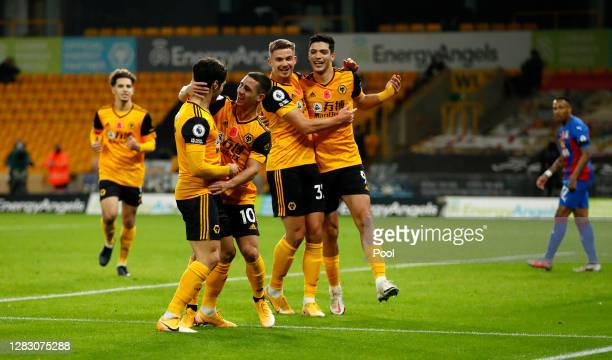 Daniel Podence of Wolverhampton Wanderers celebrates with teammates after scoring his team's second goal during the Premier League match between...
