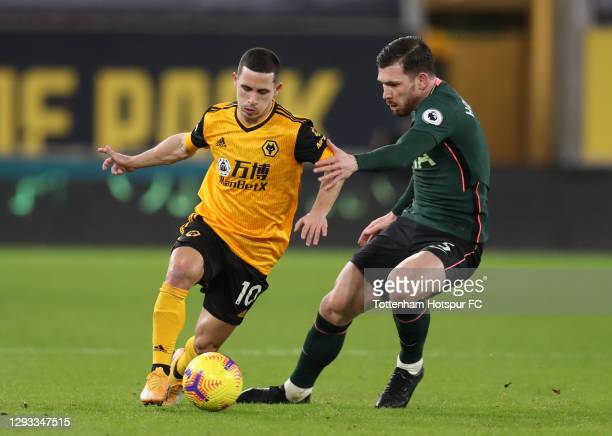 Daniel Podence of Wolverhampton Wanderers is challenged by Pierre-Emile Hojbjerg of Tottenham Hotspur during the Premier League match between...