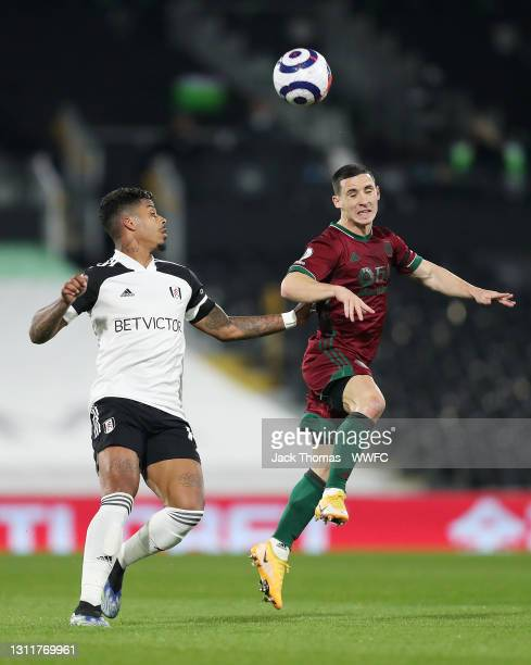 Daniel Podence of Wolverhampton Wanderers is challenged by Mario Lemina of Fulham during the Premier League match between Fulham and Wolverhampton...