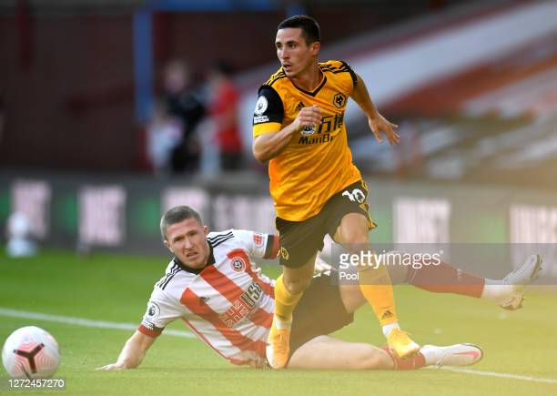 Daniel Podence of Wolverhampton Wanderers runs with the ball past John Lundstram of Sheffield United during the Premier League match between...