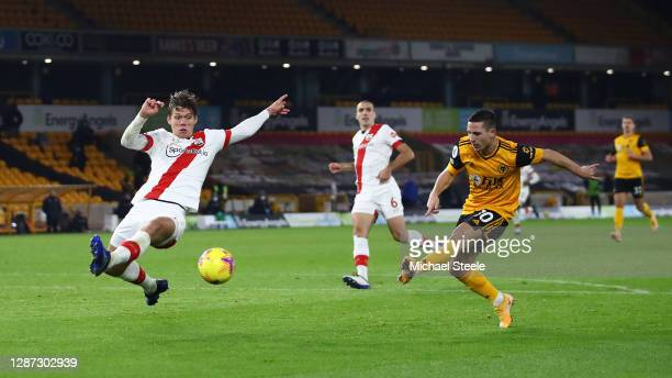 Daniel Podence of Wolverhampton Wanderers shoots as he is challenged by Jannik Vestergaard of Southampton during the Premier League match between...