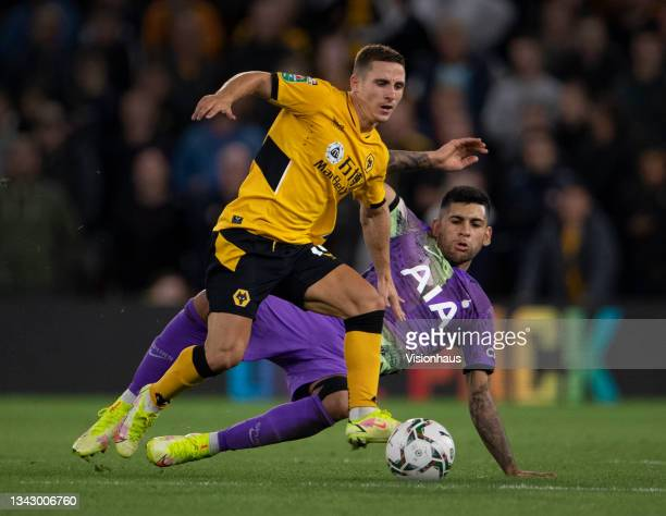 Daniel Podence of Wolverhampton Wanders in action with Cristian Romero of Tottenham Hotspur during the Carabao Cup Third Round match between...